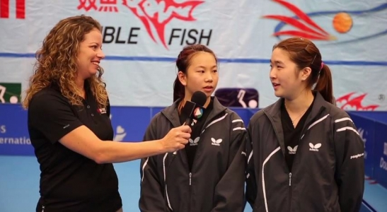Michelle Hohne interviewing two young athletes.