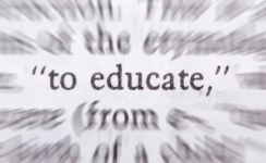 The word educate highlighted in a dictionary
