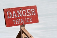 A sign that says caution thin ice.