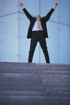 A man in a business suit cheering