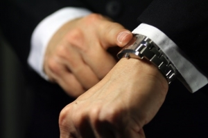 Closeup of a man pointing to his watch