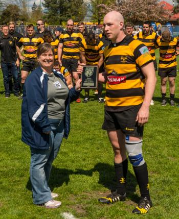 Tanya presenting the Men's 1st Division Runners-up Trophy to Nanaimo Hornets RFC
