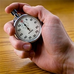 A hand clicking a stop watch