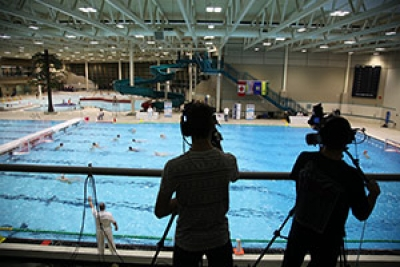 Two BCIT students filming a water polo game