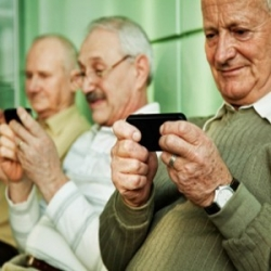 A few senior citizens browsing on their phones
