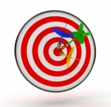 A target with three darts pinned in the center circle