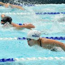 Swimming athletes in action