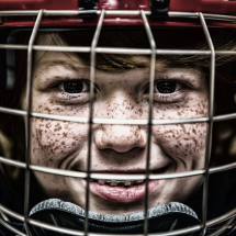 Boy with a hockey helmet on