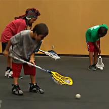 Youth learning lacrosse