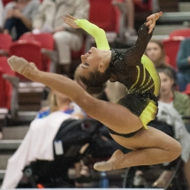 Rhythmic Gymnastics athlete posing mid-air