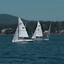 Two sailboats mid-race