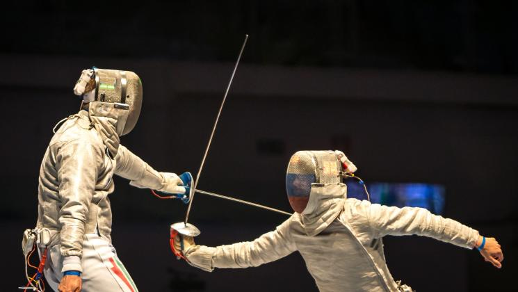 Two Athletes Fencing
