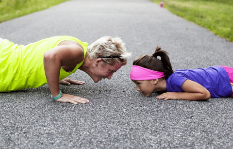 Woman and girl doing push up