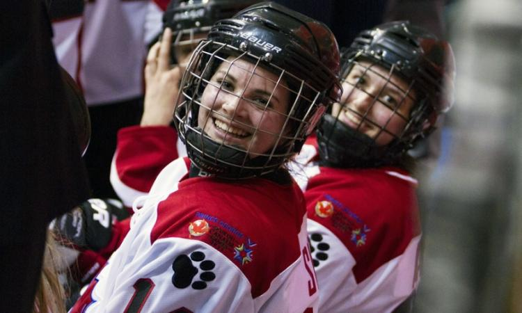 Two female hockey players