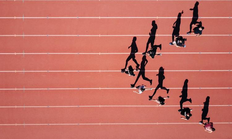 Athletes running on a track