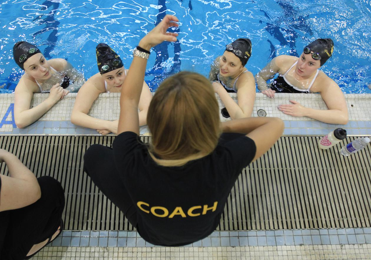 Synchro coach with athlete